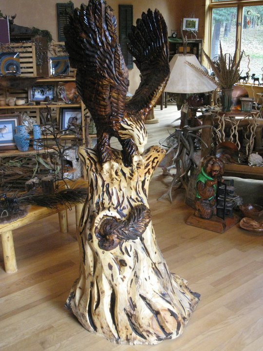 Chainsaw carved eagle hunting a squirl